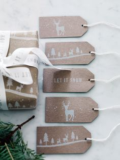 Designed to co-ordinate our exclusive Midwinter Forest Wrapping Paper, this set of fifteen high quality gift tags come in three exclusive designs and each include simple white twine for fixing. Every design is printed on a quality craft card background, with five 'Let It Snow' tags, five with a reindeer and five with our exclusive Midwinter scene.
