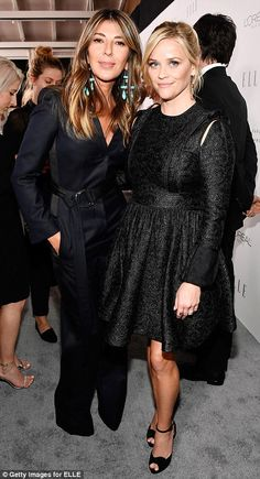 Friends in high places: Reese happily posed withELLE editor-in-chief Nina Garcia (L) and...