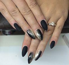 Glittered matte black nails