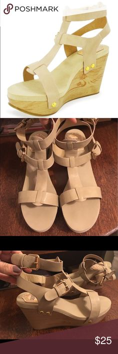 """Desire by Jacobies Riva Platform Wedge Sandal                                          Sizing: True to size.  - Open toe - Multi T-strap - Dual adjustable buckle ankle closure - Wood detail wedge heel and platform - Memory foam insole - Approx. 4"""" heel, 2"""" platform  Materials Synthetic upper and sole Desire by Jacobies Shoes Wedges"""