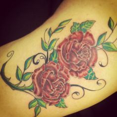 Thigh tattoo Rose and thorns