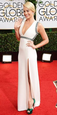 Golden Globes 2014: Arrivals : Margot Robbie brightens the Red Carpet with this beautiful white gown with emerald detail...