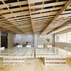Over 100 wooden transport pallets were broken downto create floorboards, wall coverings and furniture for a temporary office space in Tokyo
