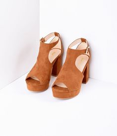 A perfect pair of retro straps, gals! An elegant chestnut brown, crafted from faux suede, featuring a peep toe and 3.5 block heel and 1 platform for a disco lift! An adjustable t-strap ankle provides a secure fit with goring for movement, while the cush