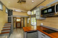 300 Sq Ft Custom Tiny Home on Wheels by Wishbone Tiny Homes This is what I've been envisioning on the stairs but higher up so you could sit on a small landing and look out the window. Love the closet placement though. Tiny House Nation, Tiny House Trailer, Tiny House Plans, Tiny House On Wheels, Tiny House Layout, Tiny House Design, House Layouts, Tiny House Big Living, Small Living