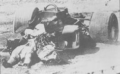 Monza F1 GP practice, 1970 Jochen Rindt, lying near death in his car right after his hard crash in a Gold Leaf Lotus 72C Gold Leaf. An apparent brake failure led to Rindt losing control of his car in a fast corner, then plowing into and under a barrier, then spinning aimlessly. There was no fire, but the German died instantly of severe neck injuries.