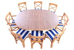 A bamboo dining table and eight chairs newly upholstered in Sunbrella.