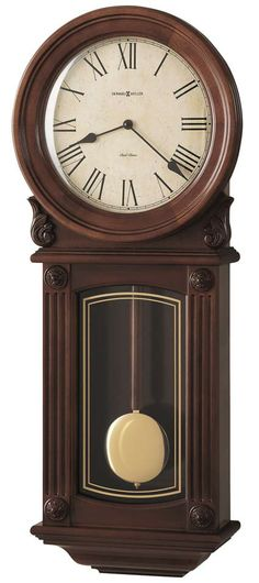 The 77th Anniversary Edition Cherry Wall Clock has a pair of carved shell overlays and a wood bezel. The aged dial features black Roman numerals and classic spade hands. A gold-tone design detailing on the lower glass draws attention to the wood and brass finished pendulum. The glass is framed by reeded columns with carved rosettes. Finished in Windsor Cherry on select hardwoods and veneers. Quartz, dual chime movement plays Westminster or Ave Maria chimes. Size: H. 28 W. 11-1/2 D. 4-1/4…