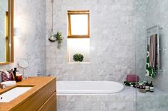 An airy Sydney home bursting with colour and print: Marble bathroom featuring the new Unikko and Taimi towels and accessories.