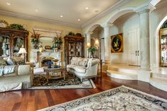Formal living room with cast stone fireplace.