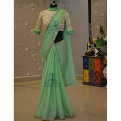 This is a Green Colored Beautiful Embroidered Rangoli Silk Saree Wedding/Party Wear Bridal Saree. This Saree comes with an attached Banglori Silk blouse fabric. Wear this saree for special occasions, festivals, friends/family get-together, parties Sari Blouse Designs, Saree Blouse Patterns, Fancy Blouse Designs, Indian Designer Sarees, Indian Designer Outfits, Indian Sarees, Saree Designs Party Wear, Party Wear Sarees, Simple Sarees
