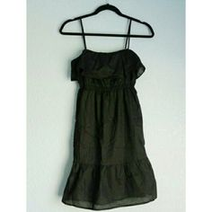 GAP | Casual Cotton Ruffle Sun Dress Black cotton sun dress with ruffle details at hem and bust.  Thin, adjustable straps. Can be dressed up or down. 100% Cotton w/ polyester lining underneath. Worn once, still like new. Size 0 or XS (Can be a little tight at the chest). Price is firm. No trades GAP Dresses