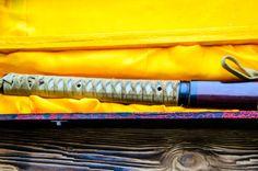 japanese sword katana in box on wooden background