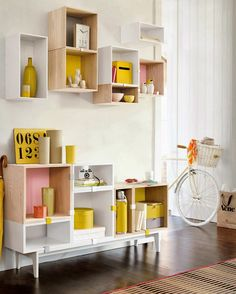 Pastel and natural wood boxes assembled in a chest and a shelve via Poppytalk