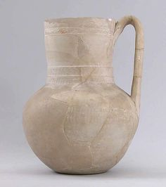 Jug  Date: 9th century Geography: Iran, Nishapur Medium: Earthenware; covered with slip and incised, unglazed