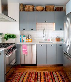 woven baskets, blue grey cabinets, kilim rug