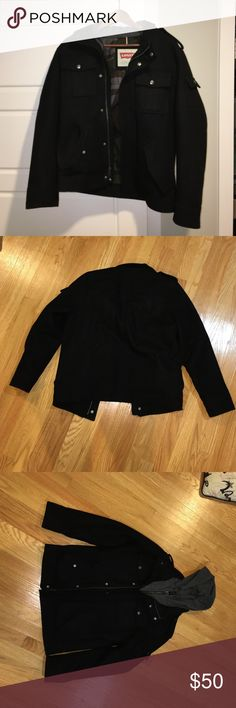 Levi's Hooded Jacket Great Condition black jacket with grey hood. Extremely stylish with no scuffs, cuts, or stains. Loved this jacket but it is too small for me now. Levi's Jackets & Coats