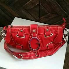 """Red Guess Purse w/ Matching Wallet Authentic leather Guess purse. Beautiful condition, like New!! 12""""L x 5.5""""H x 4""""W, strap drop 11"""". (measurements approx.)  Tiny black mark on pocket on the inside.  Comes with matching wallet. Wallet NWOT/never used. Wallet brand unknown. Guess Bags"""