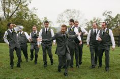 i love these candid groomsmen in charcoal grey vests & pants |  Alexa & Tucker's gorgeous, Fall boho-inspired Virginia wedding at Bluemont Vineyard | Images: Kristen Gardner Photography