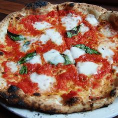Best Pizza Places : Flour + Water in San Francisco | The phenomenal pizza margherita (tomato sauce, Fior di Latte and extra-virgin olive oil) has delicious puffy and charred cornicione (end crust), the result of just two minutes in the 800-degree wood-burning oven imported from Italy.