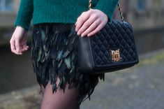RED REIDING HOOD: www.redreidinghood.com Fashion blogger wearing feather skirt love moschino quilted designer bag outfit details