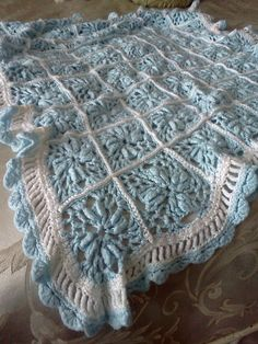 Granny Square Afgan for Baby Boy Inspiration. Could be done with square pattern of choice. Love the blue blocks trimmed in white, and white and blue lacy edging