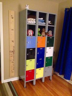 Lockers I refurbished for my son's room. This will be his dresser. They were dull tan and scratched/rusted with no locker numbers. I took all the doors off and painted the frame then painted the doors individually and riveted them back on. I bought some vintage locker tags on eBay and riveted those on the doors. I also left 6 doors off to leave open shelving on top. Lastly, it is bolted to the wall so it doesn't fall over when he inevitably tries to climb it!