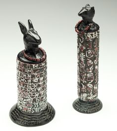 This is made of polymer...but inspirational for clay....Nan Roche, Animal Auguries, c.1998  polymer & elastic, 6.5″h x 3″h x 2″d and 7.2″h x 2″h x 2″d  Racine Art Museum Photo: Penina Meisels