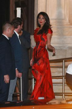 Lady in red, seen in Venice before her nuptials in 2014. See all of Amal Clooney's best looks.