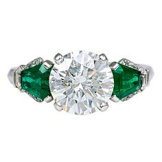 YARD Diamond and Emerald Ring - no idea what a yard diamond is, and I'm not a huge fan of diamonds or traditional jewelry, but I kinda like this.