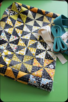 great colors, great fabrics; like using same fabric for pinwheels & changing backgr fabric