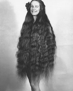 Mary Tucker grew her knee-length hair to more than floor-length over the decades. Her very brown hair was remarkably dense and heavy...photo by Stan Shuttleworth.