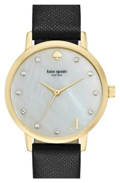 A monogram letter marks 5 o'clock on the lustrous mother-of-pearl dial of this elegant timepiece touched up with sparkly crystal detailing and set on a textured leather strap.