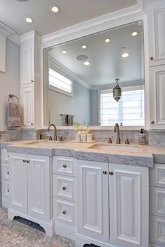 Dual sinks with individual cabinets:) Same vaulted ceiling I have, too.