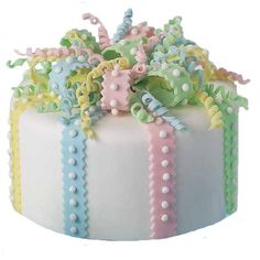 Curly Bow Cake - Place this meant-to-impress parcel center stage at baby showers, birthday parties and springtime buffets. Wrap a white-fondant-covered cake in colorful fondant ribbons and bows shaped with our Ribbon Cutter and Embosser Set.