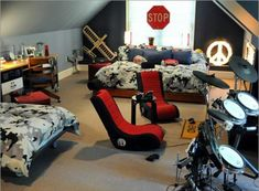 This is the perfect shared bedroom for preteen brothers/teens (judging by the larger bed near the prime window spot, I'm guessing teen/preteen sharing). This bedroom is rocking with camo, games and a drumset!