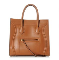 ee0893e1a09 This is an authentic CELINE Natural Calfskin Small Phantom Luggage in Tan.  This is a