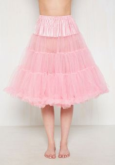 Thanks to this pink petticoat, your sprightly skirts and dresses bob with whimsy and vivacity. This classic undergarment features an elasticized waistband, flirty ruffles, and two full layers of tulle that are smooth to the touch and sassy in shape, making every twirl, skip, and kick so much more fun!