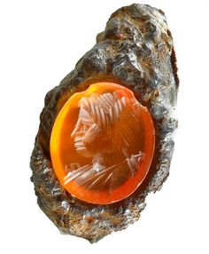 A translucent orange gem engraved with an image of a goddess Diana of hunting found near a mausoleum built by Herod the Great, the king of Judea. After 71 AD.   Photo: Tal Rogovski