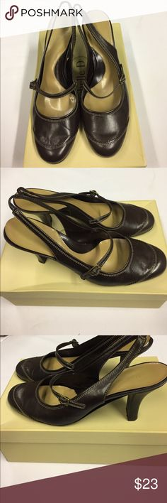 Michelle D 2.25in Heels. Brown with Buckle Strap across the foot and a heel strap. Leather 2.25in Heel with Tan Stitching around the shoes. Lite signs of wear on shoes and bottoms. Michelle D Shoes Heels
