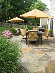 Flagstone patio landscaping with ornamental grass and beautiful hydrangeas