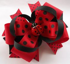 Here is my great friend @Justine Pocock  She makes hairbows and its the only place I buy Adrielle's!!!!   Red and Black 5 inch Lady bug Boutique Hair Bow...