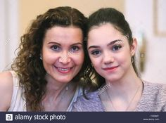 Moscow, Russia. 12th April, 2016. Figure skating coach Eteri Tutberidze (L) and 2016 World champion, Russian figure skater Evgenia Medvedeva attend a ceremony to award Russian figure skaters following the 2016 ISU World Figure Skating Championships in Boston, USA. Medvedeva was awarded the title of Honored Master of Sports during the ceremony. Credit:  ITAR-TASS Photo Agency