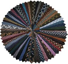 These are large floor rugs made from secondhand mens ties. Approx 60-70 ties in each. The ties are joined together with a close zigzag stitch.