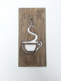 This wooden coffee wall art plaque is made from a solid pine board and measures 12 inches tall by 5 1/2 wide and 3/8 thick. Modern minimalist