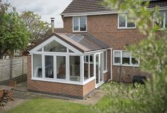 Add more light and room to your home with a solid roof conservatory. Conservatory Ideas Sunroom, Replacement Conservatory Roof, Conservatory Interiors, Conservatory Extension, Conservatory Kitchen, Bungalow Extensions, Garden Room Extensions, House Extensions, House Extension Plans