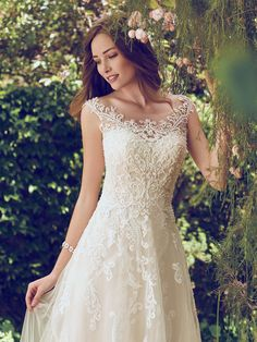 Rebecca Ingram - ALEXIS, This flirty A-line gown features distinctive crosshatch motifs embellished with Swarovski crystals, delicate beading, and sequins. Illusion details accented in lace appliqués create beautiful back interest. Finished with covered buttons over zipper closure.
