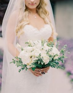 Gorgeous Poolside Wedding At A Private Residence In Orange County: This white bouquet pairs perfectly with the lace sweetheart neckline