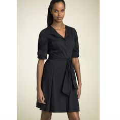 "Elie Tahari Sz 2 Black Soft Sateen Button Up Dress Elie Tahari Sz 2 Black Soft Sateen Button Up Bow Cap Sleeve Belt Dress NWOT.  Short sleeve bow cuffed sleeves.  Matching self tie waist sash.   Button down the front.  Size 2 Bust: 32-34 Waist: 15"" Length: 39"" Elie Tahari Dresses"