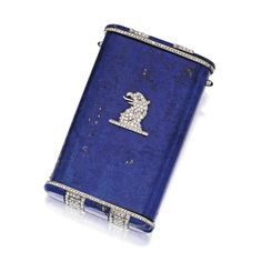 PLATINUM, DIAMOND, LAPIS LAZULI AND SAPPHIRE CIGARETTE CASE, JANESICH The case formed of one hollowed section of lapis lazuli, the top and b...